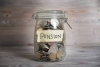 image of jar filled with coins representing a pension fund